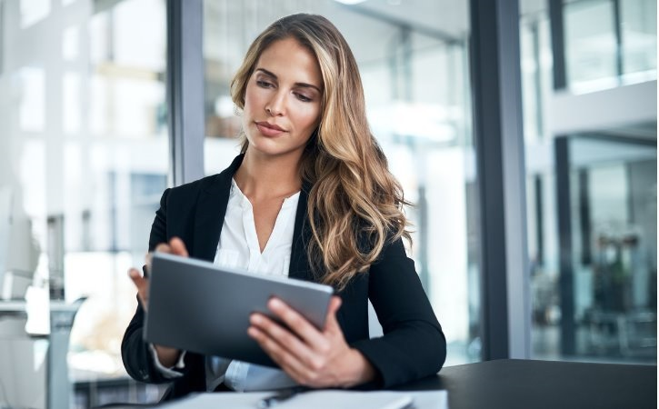 Businesswoman in an office building using a tablet.
